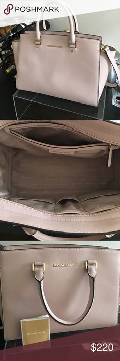 Michael Kors Selma Large Saffiano Leather Satchel Michael Kors Selma Large Saffiano Leather Satchel. This bag is in GREAT condition, like-new. Very small unnoticeable scuffs on the back of the bag (see photo). No marks or stains on the inside of the bag. Michael Kors Bags Satchels