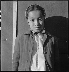 Manzanar Relocation Center, Manzanar, California. A young evacuee of Japanese ancestry at this War Relocation Authority center. 1942 Dorothea Lange