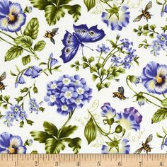 Botanical Blues Flowers & Butterflies Cream from @fabricdotcom  Designed by Tracey Sims for Northcott Fabrics, this cotton print is perfect for quilting, apparel and home decor accents. Colors include shades of indigo, green, yellow, and white.