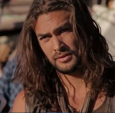 Jason momoa looking rough and ready and deep in thought