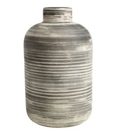 White/black striped. Large, cylindrical stoneware vase with a grooved finish. Diameter at top 1 1/2 in., height 8 1/4 in.