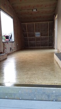 Sanded and sealed OSB subfloor becomes the finish floor.