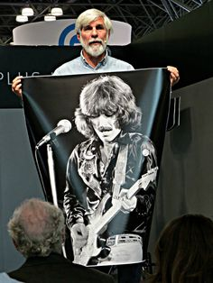 Digital photography pioneer Stephen Johnson displays his photograph of George Harrison while speaking on film copy and reproduction at the 2016 PhotoPlus Expo at the Javits Convention Center in New York City. October 20, 2016.