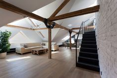 Built by B² Architecture in Prague, Czech Republic with date Images by Alexandra Timpau. This loft apartment located in a late century house presents an interesting challenge: how to recover the gracef. Attic Design, Loft Design, House Design, Open Stairs, Attic Stairs, Attic House, Attic Loft, House 2, Attic Apartment