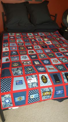 Quilt using Tumbler pattern with tracks between each tumbler. Perfect for displaying travel patches, scout badges or military patches. Inspiration for quilt from Jenny of Missouri Star Quilt company and her video tutorial.