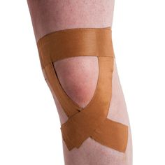 Here's a taping technique for patellar tendinosis (jumper's knee) to help treat the pain. Full instructions and pictures from Physical Sports First Aid.