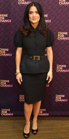 Salma Hayek Pinault launched Chime for Change with Gucci in a structured skirt suit, gold bangles and suede peep-toes.