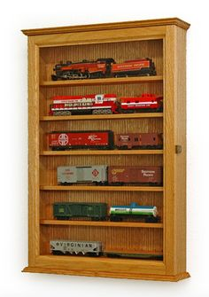 The perfect model train display case awaits! These glass display cases are great for any collection of any size. Choose your favorite style of wood or customize it yourself. The possibilities are endless!
