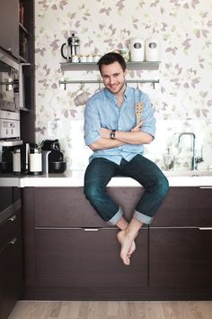 """We love this guy! Norwegian TV host Stian Barsnes-Simonsen is a master in the kitchen! Here he poses in it, in the very first issue of KK Living. """"I love gourmet food!"""" Photo by Astrid Waller Our Love, Food Photo, Gourmet Recipes, Guy, Homes, Kitchen, People, Houses, Cooking"""