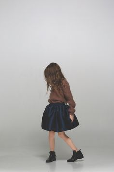 Chunky knitted jumper and a full volume taffeta skirt. Girls fashion at its best, by Little Remix (Danish brand) for AW16.
