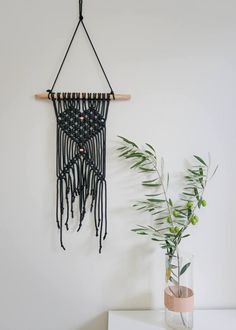Macrame wall hanging. Copper on black cord. Sleek and modern. A heart macrame pattern made with 6mm black polyester string, featuring raw copper pipe. Hand made in Australia from polyester cord, Australian Wattle branch and copper pipe. Measures 36cm x 92cm