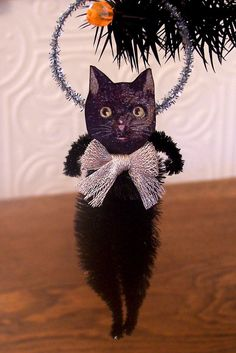 Black Cat Vintage Style Feather Tree Ornament. $8.95, via Etsy.