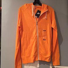‼️FINAL PRICE ‼️NWT Nike zip hoodie NWT Nike zip hoodie in orange color. Has two side pockets and drawstring hoodie. ⛔️ PRICE IS FIRM ⛔️ Please bundle for additional discounts  Nike Tops Sweatshirts & Hoodies