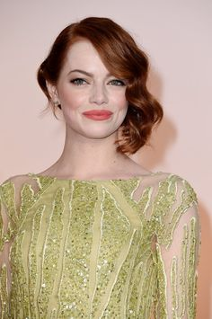 Pin for Later: Emma Stone's Glamorous Oscars Hair Will Make You Want to Get a Lob Emma Stone's 2015 Oscars Beauty Look