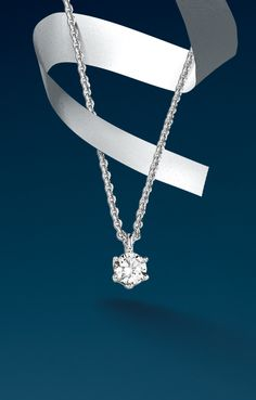 """A perfect way to say """"I love you"""" with #Bucherer #solitaire #pendant with chain in #whitegold with brilliant #diamond. #MomentOfRomance #weddingseason #bridal #jewelry"""