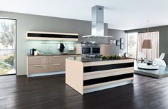 Are you looking for kitchen design ideas? You'll also want to avoid these two common kitchen design mistakes when planning your new kitchen. Commercial Design, Commercial Interiors, New Kitchen, Natural Wood, Kitchen Design, Mistakes, Table, Articles, Design Ideas