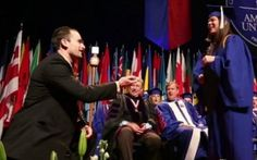 Video of a surprise proposal at American University's commencement to receive her diploma.