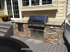 The outdoor kitchen on this deck is tucked nicely into an efficient space close to the house.