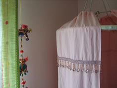 Love this DIY version of a reading nook tent! Just a hula hoop, bed sheet, and some bedazzling.