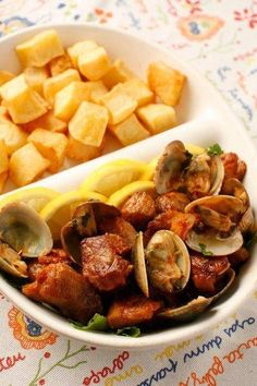 carne de porco á alentejana (Typical on the south in Alentejo); Pork cooked with clams and served with chips