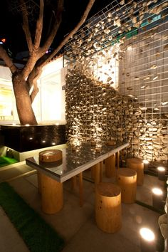 Cafe Ato by Design BONO, Seoul  Gabion wall with floating stones. Night lighting