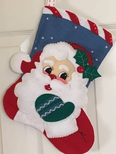 This is a finished handcrafted 15 Bucilla Felt Christmas Stocking. It is all hand stitched, appliqued, sequined and beaded. There was no glue or machine stitching used. The stocking is fully lined. Someone gave my twins these 38 years ago and they still use them every year. I have made these for
