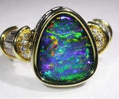 18 K GOLD OPAL RING FROM QUILPIE OPAL COLLECTION NO 32  BLACK OPAL MULTICOLOUR GEMSTONE FROM  QUILPIE, AUSTRALIAN  OPAL, ABSOLUTELY GORGEOUS