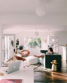 fresh lightful living room with green sofa