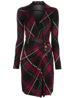 Red vintage dress from Gucci featuring a tartan style design with contrasting black and green colouring, a large classic collar, a bronze-tone safety pin fastening at the hip that creates a gathering of fabric, a v-neck and long sleeves. Please note that vintage items are not new but often between 20 and 50 years old, and therefore will always have minor imperfections