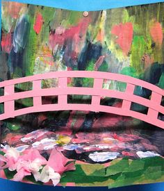 Monet bridge: The class painted a background with impressionistic paint adding a bridge and base of card and tissue paper, stretched and attached to the edges. Causing the background to curve