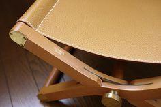 "Hermès "" Pippa "" Shrunken Calf Leather & Natural Pearwood Folding Stool with Brass Hardware."