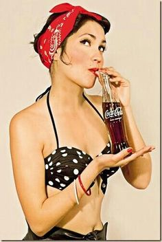 An old poster of advevertising of soda #thecocacolacompany..