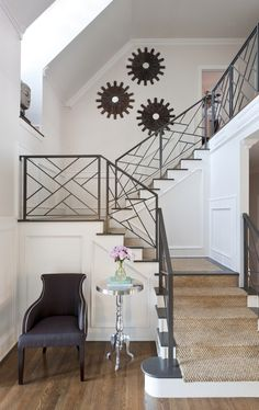 Gray stairs, sisal stair runner, and those railings!