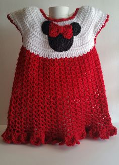 "Girl Mouse 12 mos Red Dress. This dress is red and white. This dress is inspired by Minnie Mouse. It is perfect for a 1st birthday party or any special occasion. This dress is hand crocheted with ""Sim"