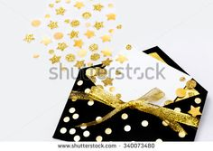 Celebratory envelope with a blank card and confetti - stock photo