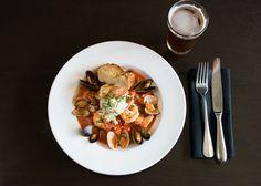 Dungeness Crab Cioppino: tuna, salmon, mussels, clams, prawns, saffron broth, garlic toast