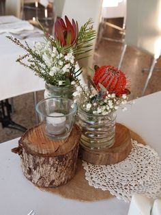 Wedding Table Decorations Australia rustic stumps as wedding centrepieces with australia native flowers - Table Settings Wedding Table Centres, Wedding Table Centerpieces, Wedding Table Settings, Centrepieces, Flower Table Decorations, Silver Wedding Decorations, Christmas Table Settings, Christmas Tables, Holiday Tables