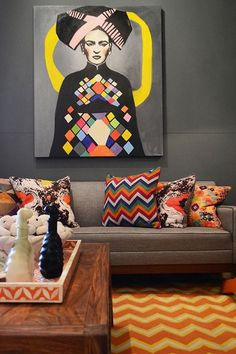 This is a very cool take on Frida Kahlo. Take it as a starting point and style your sitting room with graphic and other arty cushions, some graphic home accessories like this tray and a nice zig-zag carpet.