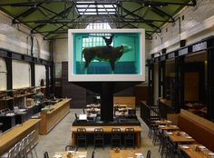 Mark Hix's East London restaurant, Tramshed, Rivington Street, EC2. Chicken and beef please. British food in an industrial setting surrounded by modern art including Damien Hirst's cow and chicken in formaldehyde. Amusing cocktail list. Tasty shared starters.