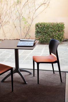 E-motion chair, designed by Giancarlo Piretti, and K4 table, created by Bartoli Design for #Segis. #ItalianDesign www.segis.it