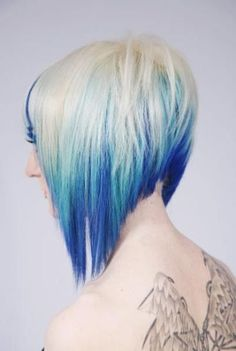Straight Blonde Hair with Uneven Bangs and Blue Highlights look hairstyle