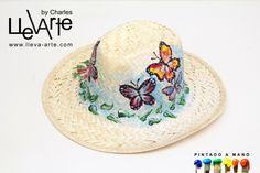 Sombrero en fibra natural pintado a mano. www.lleva-arte.com