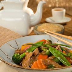 Tea Stir-fry Recipe with water, Lipton Green Tea with Mandarin Orange Flavor Pyramid Tea Bag, soy sauce, firmly packed brown sugar, corn starch, olive oil, pork tenderloin, stir fry vegetable blend, garlic, ground ginger
