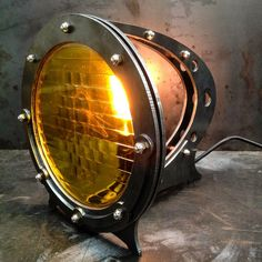 Captain Nemo and the crew of the Nautilus should have had this on their deep sea adventures but unfortunately we werent born yet. As I boy I was fascinated with science fiction so this lamp comes from those early impressions. As with all our pieces this piece of functional sculpture #industriallamps