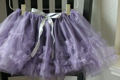 "Clare is big on spinning and ""running in circles"" these days. A new dancing skirt was in order. Here is one way to make a charming, quick tutu. A wonderful last minute birthday gift for…"