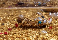 Artist Hubert Duprat Collaborates with Caddisfly Larvae as They Build Aquatic Cocoons from Gold and Pearls