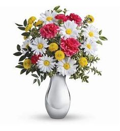 Sure to put a smile on anyone's face. Sunny yellow lilies, hot pink carnations and crisp white daisies arranged in a stunning Silver Reflections vase.