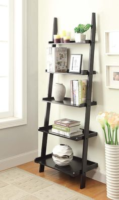 "In a classic yet simple design, this Ladder 72"" Leaning Bookcase will find it's place in any room of the house. This piece features 5 bookshelves that offer plenty of space for display or collectibles and books. Whether you find this bookshelf in the living room, or office it will be sure to fit all of your needs and earn praise in an already well furnished room."