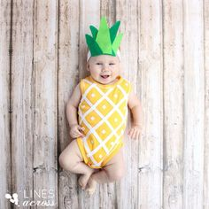 A pineapple! http://www.stylemepretty.com/living/2015/10/15/adorable-diy-baby-costumes/