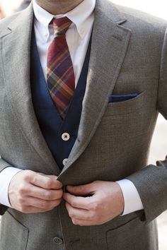 Perfect combination: Madras necktie, gray tweed jacket, navy vest, and pocket square.